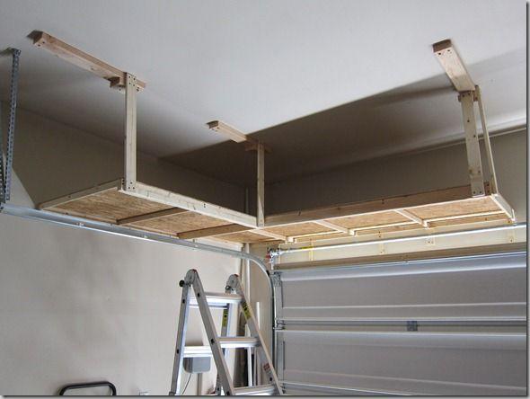 Do it yourself shelving over garage door | Garage | Pinterest