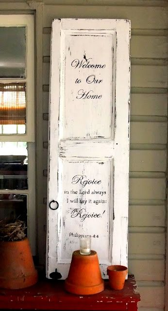 Old Shutter...re-purposed into an awesome welcome sign by the front door.