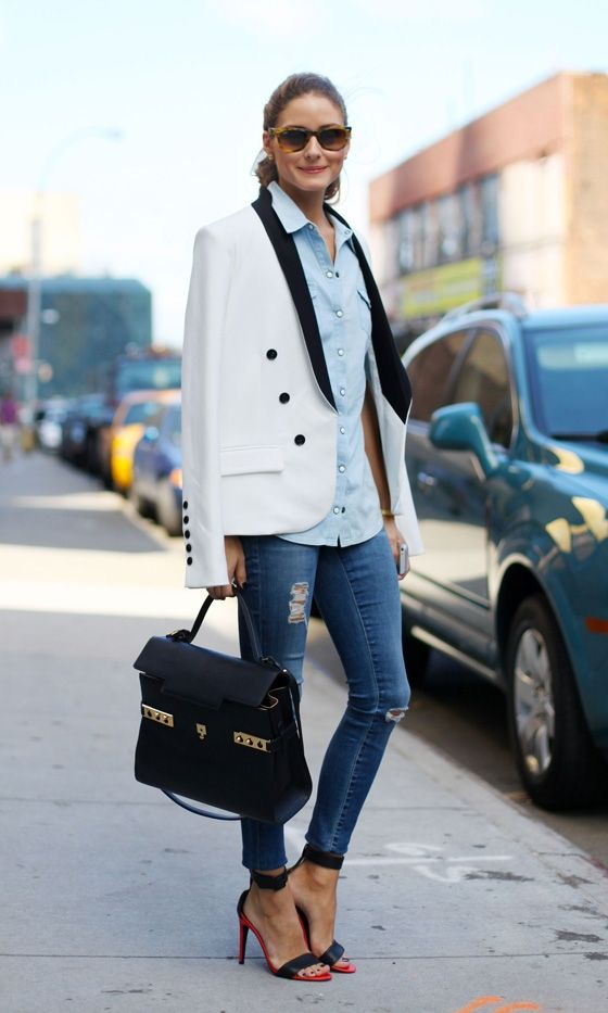 Olivia Palermo looking ever the style icon in black and white structured jacket  placed effortlessly over her laid back denim shirt at New York Fashion Week, 2013