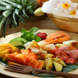 ... fruit salad made thai style with palm sugar, coconut milk, thai chili