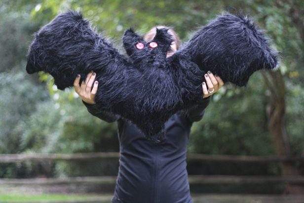 Scary-Cute DIY Bat Pillow >> http://blog.diynetwork.com/maderemade/how-to/jo-ann-fabric-crafts-halloween-silhouette-bat-pillow?soc=pinterest