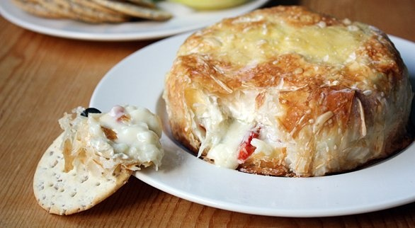 Savory Baked Brie with Sundried Tomatoes and Capers | Recipe