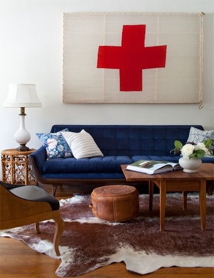 blue sofa cowhide rug and a swiss flag living rooms