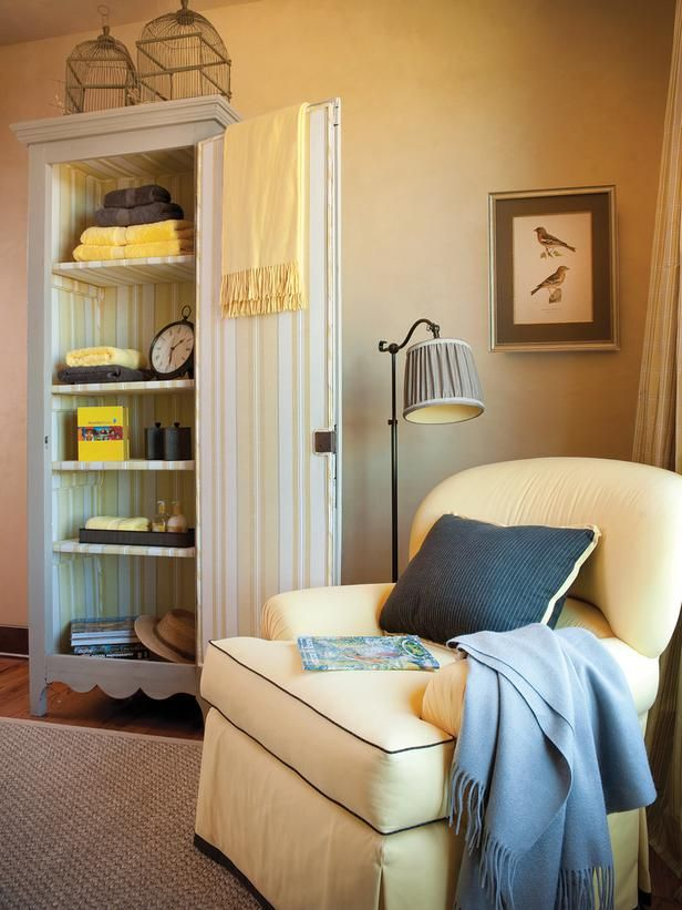 Bedroom sitting area with yellow chair and bonnetiere