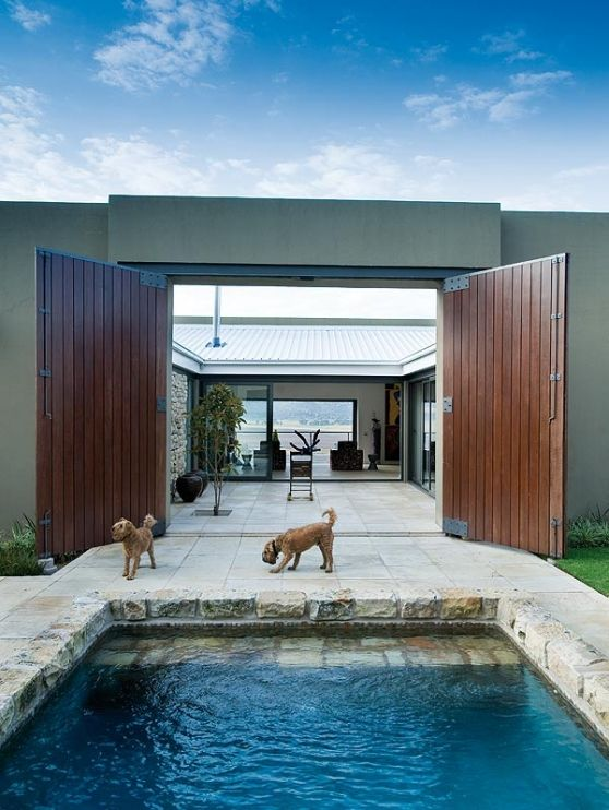 Courtyard opens to the pool.