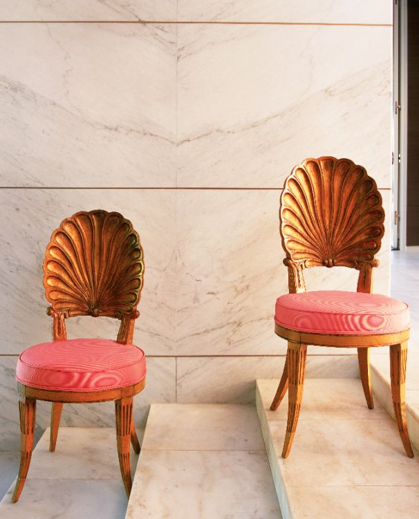 Absolutely GORGEOUS seashell-back dining chairs with coral cushions and wooden legs. | prettystuff.tumblr.com