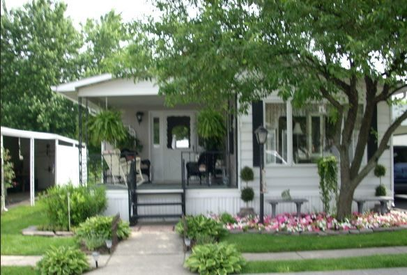 Cottage style mobile home with charming porch mobile home living