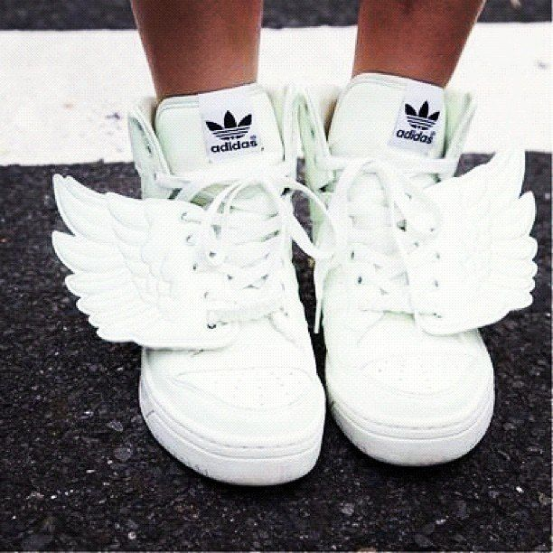 white Adidas sneakers with wings