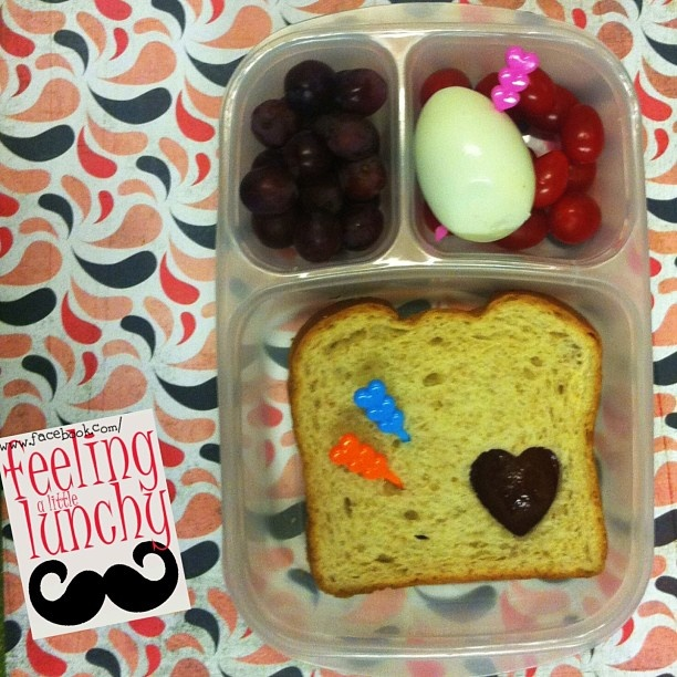 hearts all around. peanut butter and jelly sandwich, grapes, egg and ...