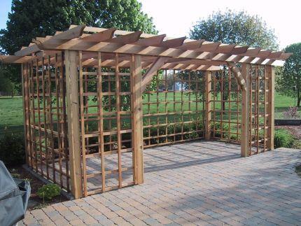 Cedar pergola fine homebuilding garden fruits herbs for Vegetable garden pergola