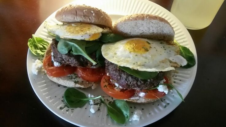 Cheddar and spinach stuffed Burgers W/ tomato, Goat cheese, and ...