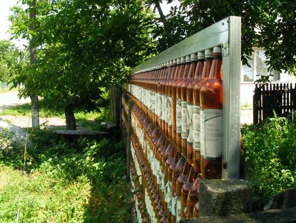 House Backyard Fence :  Recycling for Fences Built of Empty Bottles, 20 Green Building Ideas