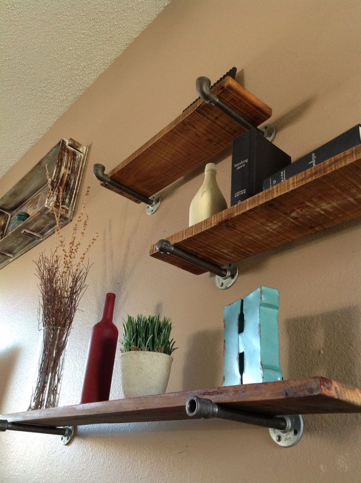 Industrial Floating Shelves. Use rough  cedar planks and plumbing fixtures. #diy