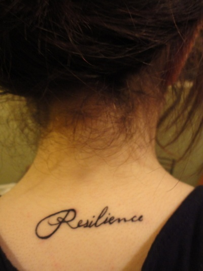 "Resilience.     ""I got this tattoo to remind me that I have used my strength and courage to not let the tough times get to me."""