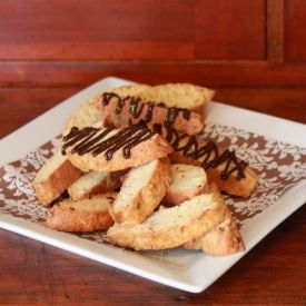 Crisp almond biscotti are covered with a drizzle of chocolate