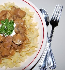 ... beef in a creamy mushroom gravy, served over hot buttered egg noodles