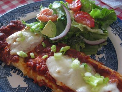 Cheesy zucchini enchiladas... Looks like a great vegetarian dish.