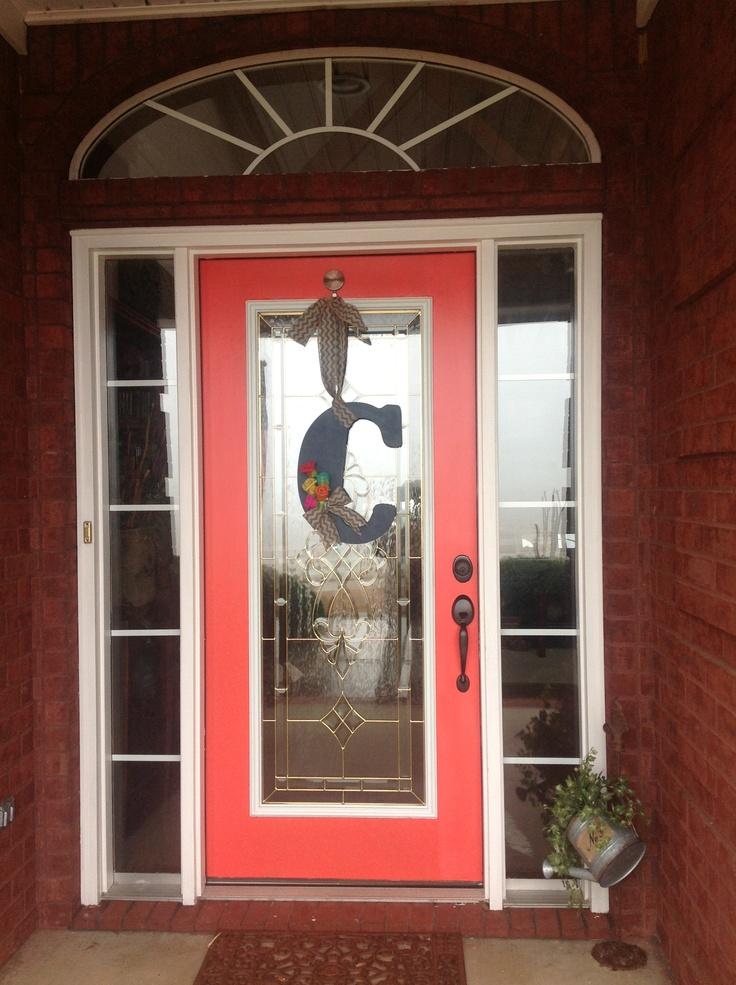 Newly painted front door with new door hanging!