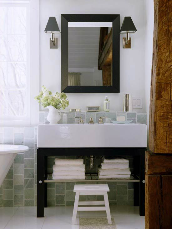 We love the look of this black-and-white open vanity. More bathrooms we love: http://www.bhg.com/bathroom/storage/storage-solutions/ultimate-storage-packed-bathrooms/?socsrc=bhgpin052312