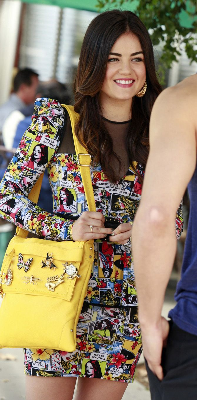 Aria's comic printed peplum dress with mesh inserts on Pretty Little Liars.  Outfit details: http://wornontv.net/17780/