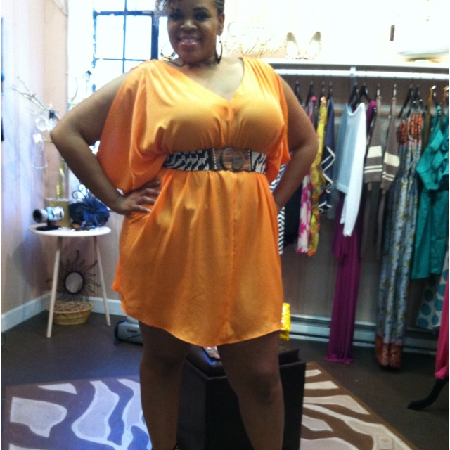Tangerine dress Model is wearing L 9199808081 to order or www.facebook.com/CuteStylzBoutique
