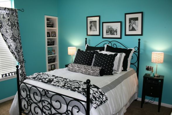 teal black and white add to the impact this room gives