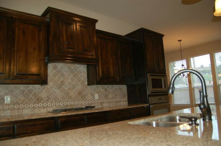 tumbled marble backsplash dark cabinets mcbee homes pinterest