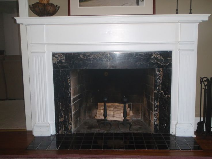 Black marble fireplace renovation ideas pinterest - Black and white fireplace ...
