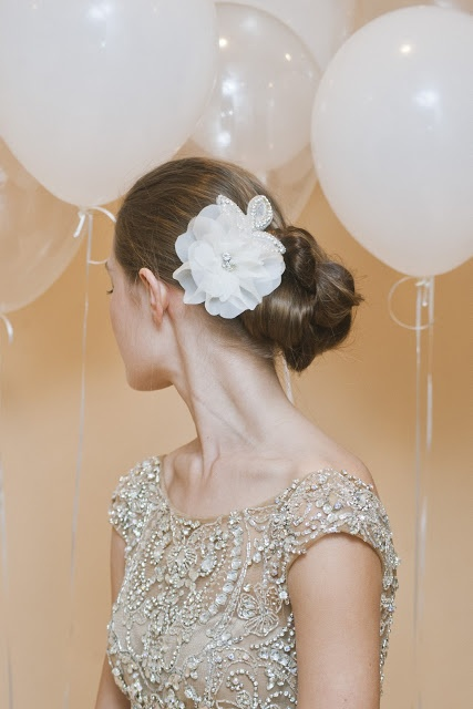 Rhinestone wedding headbands are great bridal hair accessories for brides with simple hairstyles that need an uplift. The large rhinestones gathered to make the art deco design provide a dazzling sparkle to your evening look during the reception.