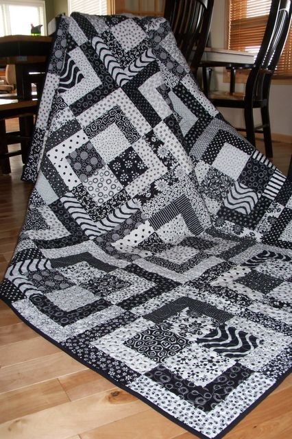 black and white quilt...stunningly different!  Have see this in multi color format - too busy - but this is great in black and white! Kudos to the designer!