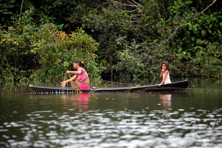 South america brazil amazon a mother and daughter tend for Amazon fishing net
