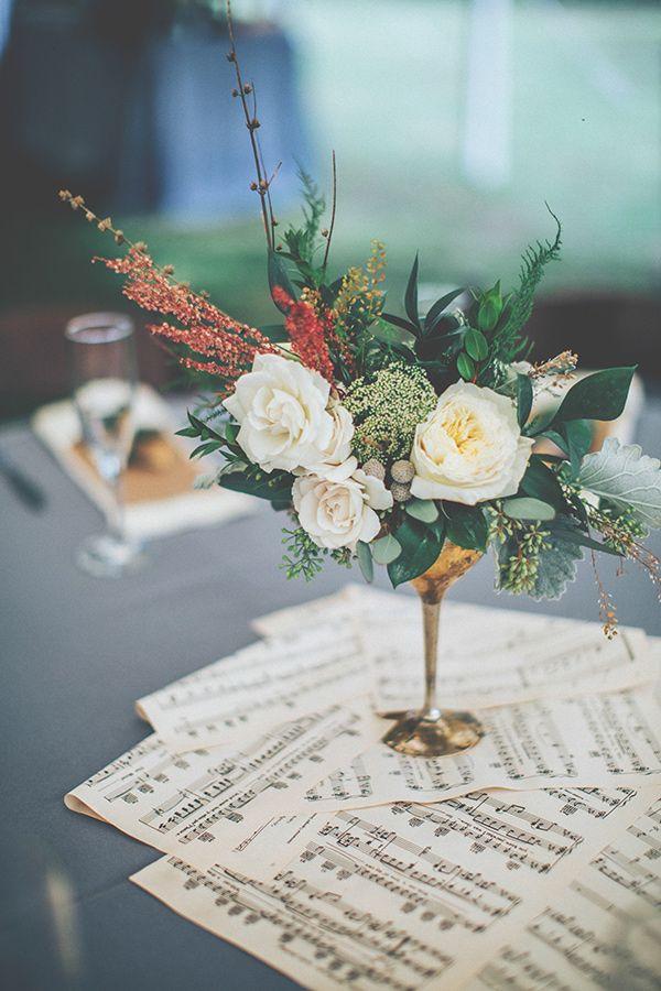 Music sheets and unique floral arrangements add to the nostalgic-feel of a vintage affair. #vintageweddings #weddingdecor