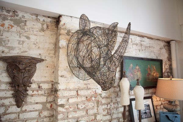 I adore Christian Siriano's interior design style.  Here's a wire frame rhino head in his bedroom.