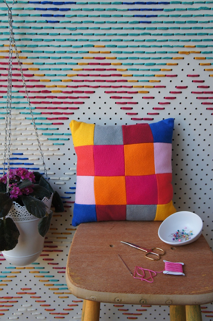 I just want the pegboard needlepoint background ..... what an awesome idea! patchwork cushion // ena and albert // $25.00