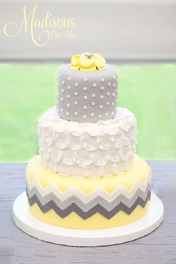 A yellow and gray wedding cake!!