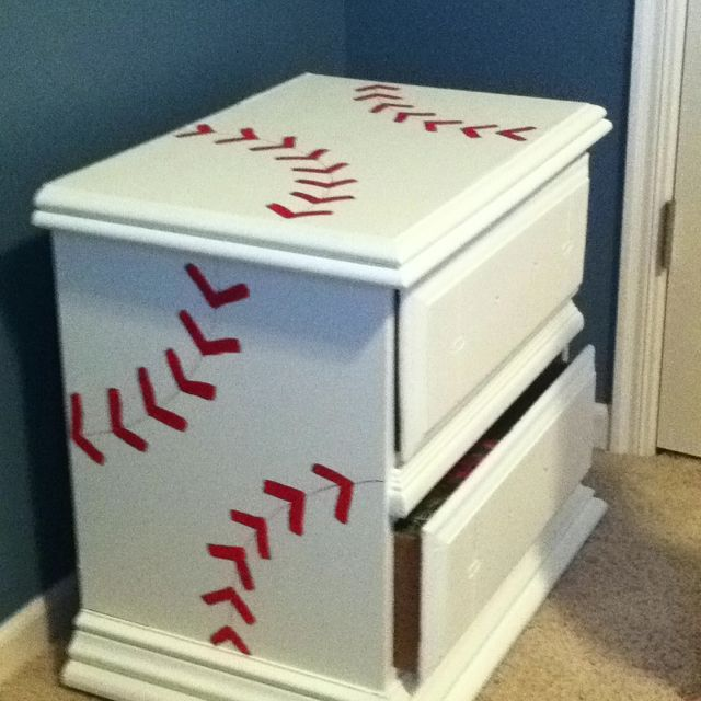 Pinner said she took an old brown dresser and night stand and painted them with white paint with primer-3 coats! Took red paint and a thin brush to make the baseball stripes- no stencil. Then took a red paint pen to draw a thin red line for the seam.