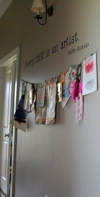 Every child is an artist. Pablo Picasso quote above kid's art.