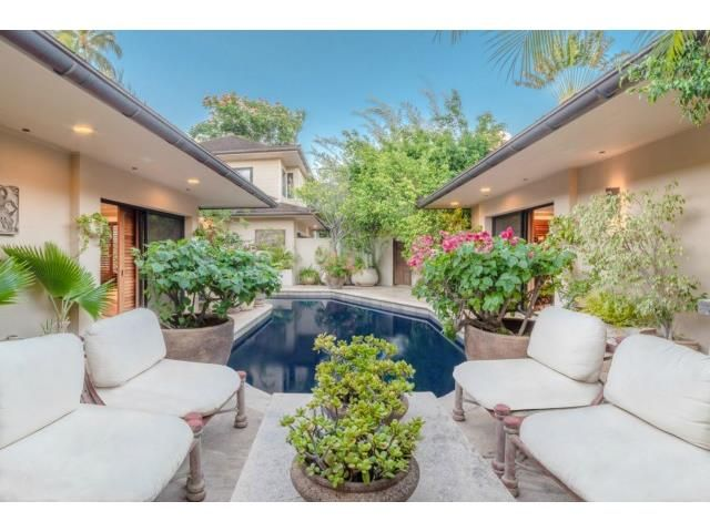 Sophisticated waterfront single level home on natural lagoon open to the ocean. It features a beautiful sitting area with views of the home's pool. Honolulu, HI Coldwell Banker Pacific Properties $3,900,000