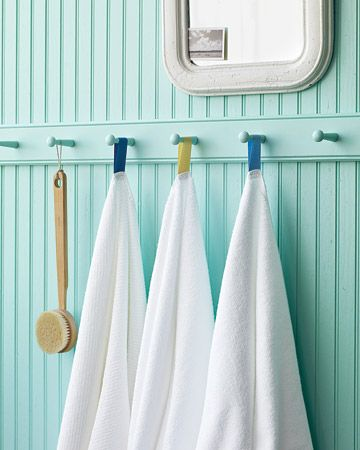 Your family and guests won't confuse their white towels if you color-code them with hanging loops. Suspended from pegs, the towels will dry quickly and stay neat.