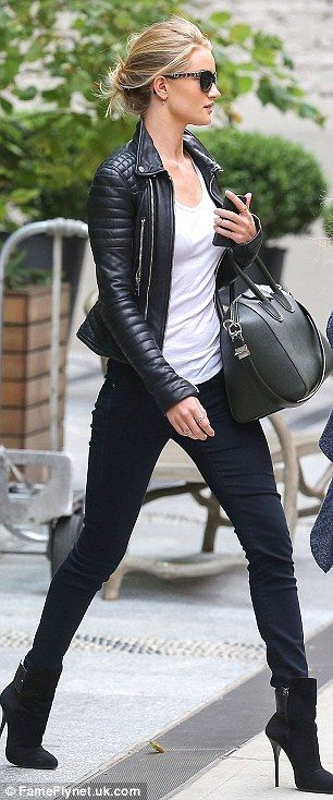 Accessory queen: Rosie teamed the jeans and boots with a white T-shirt and a stylish black leather jacket