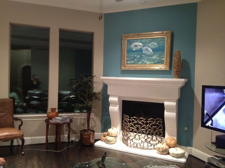 teal accent wall with white mantel fireplace pinterest