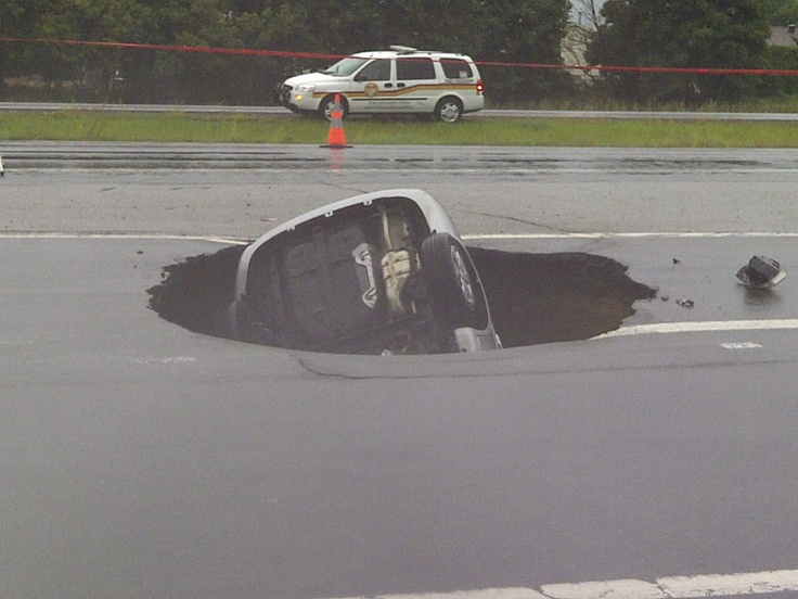 OTTAWA — Fire officials in Ottawa say a driver suffered minor injuries after a car went into a sinkhole on Tuesday afternoon.    Spokesman Marc Messier says the car fell into the hole on the Highway 174 off-ramp at Jeanne D'arc Boulevard.