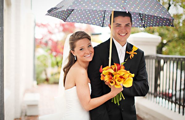 A lovely couple on their wedding day looking cheery in spite of the rain!