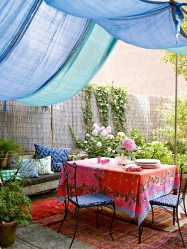 Small yard or patio idea - love the colorful awning and flowers.  Could be done in an apartment or condo.
