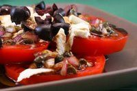 Sliced Tomato, Olive and Goat Cheese Salad with Onion-Caper Vinaigret ...