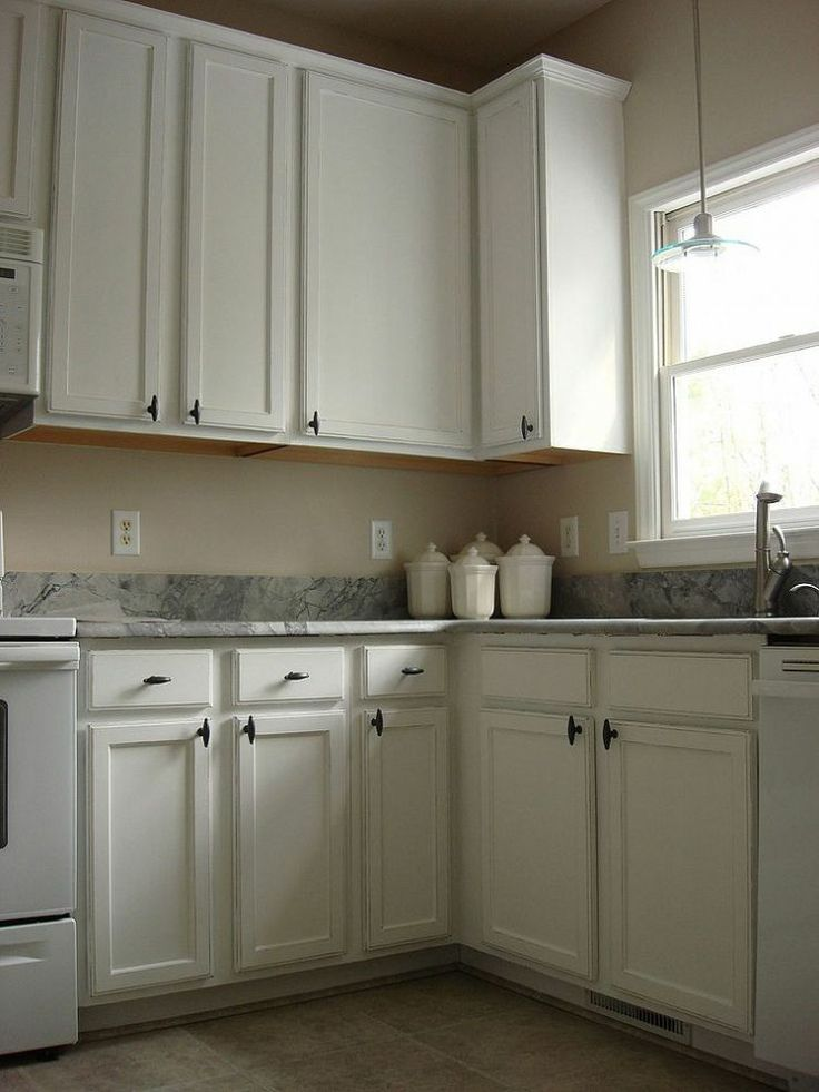 Old oak cabinets painted white and distressed for Renew old kitchen cabinets