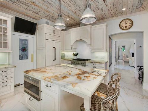 Kitchen with pecky cypress ceilings and white marble Located in Coral