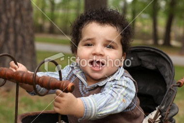 why are you sticking baby in a rusty old carriage that looks like a fireplace poker?