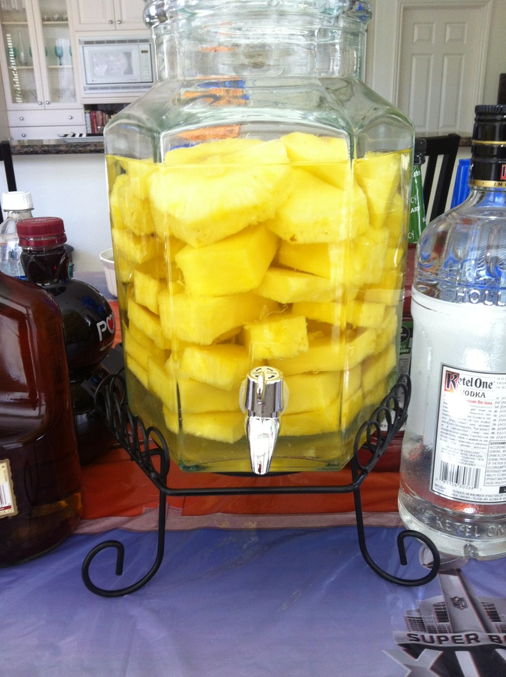 Stoli Doli's! Cut up four Dole Pineapples and layer into a pitcher ...