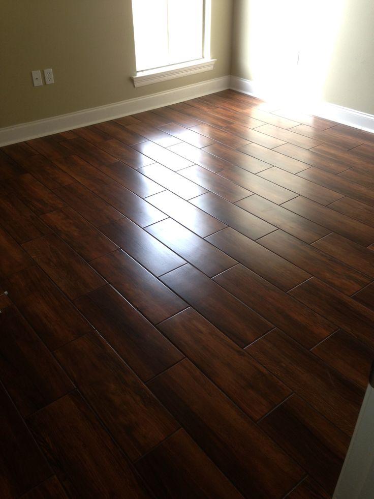 Wedge job nobile siena 8x24 wood look ceramic tile for Acadian flooring
